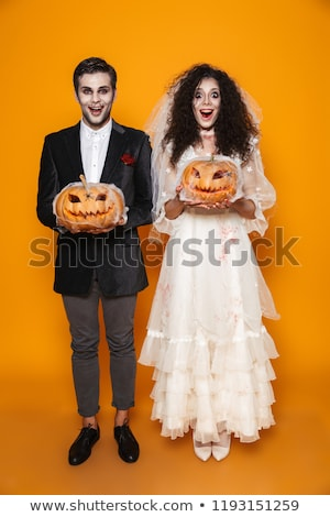 Full length photo of terrifying zombie couple bridegroom and bri Stock photo © deandrobot