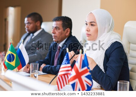 Pretty young female participant in hijab and formalwear Stock photo © pressmaster