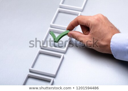 Man Hand Placing Check Mark In Box Stock photo © AndreyPopov