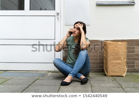 young woman waiting in front of closed door stock photo © andreypopov