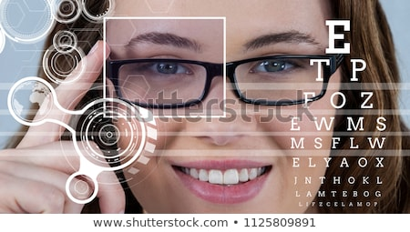 woman with eye focus box over glasses and detail and lines interface stock photo © wavebreak_media