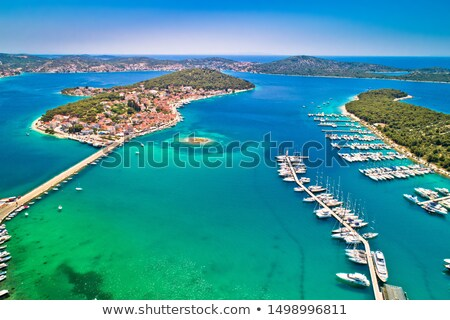 Rogoznica turquoise bay town and marina aerial view Stock photo © xbrchx