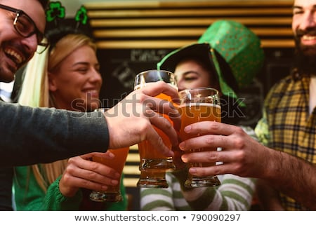 glass of beer and st patricks day party props Stock photo © dolgachov