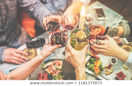 friends enjoying the drinks in the restaurant stock photo © kzenon