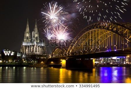 Night in Cologne at the river Rhine with fireworks Stock photo © manfredxy