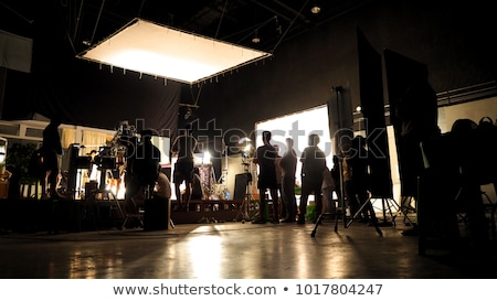 Cinema lights on a commercial video production shoot with a group of blured people at the background Stock photo © galitskaya