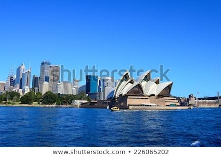 Sydney skyline kleur gebouwen blauwe hemel Stockfoto © ShustrikS