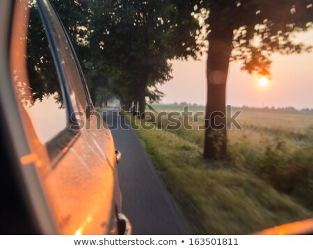 Blurred car, early morning sunrise Stock photo © deyangeorgiev
