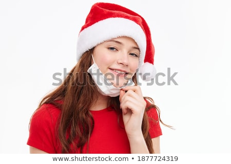 funny red haired girl in christmas cap with gift boxes stock photo © massonforstock