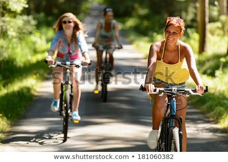 Dorastający dziewcząt jazda konna rowery znajomych dżinsy Zdjęcia stock © photography33