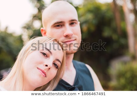 Woman with her arm on her husband's shoulder Stock photo © photography33