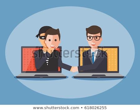 hacker · laptopot · használ · ül · asztal · fehér · számítógép - stock fotó © redpixel