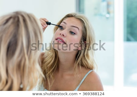 woman putting mascara makeup stock photo © ariwasabi