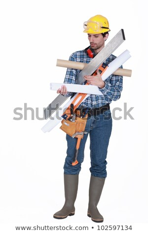 young handsome carpenter carrying miscellaneous tools Stock photo © photography33