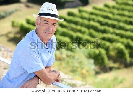 Stock photo: senior visiting a vineyard