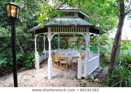 Wooden pavilion and fence in the grassland Stock photo © bbbar