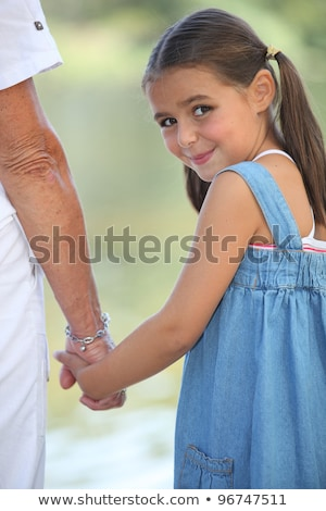 Adorable petite fille marche grand-mère famille mains Photo stock © photography33