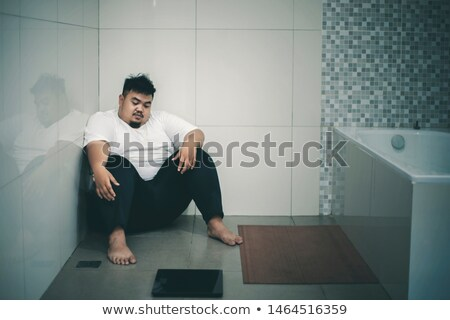 overweight fat man and scales stock photo © cookelma