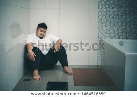 Excesso de peso homem gordo balança corpo fundo gordura Foto stock © cookelma