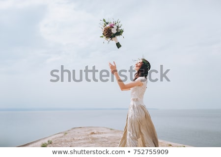 young woman throwing her dress up  Stock photo © feedough