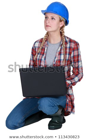 Blond builder kneeling with laptop stock photo © photography33