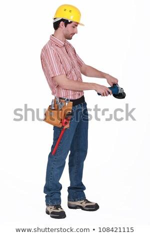 Сток-фото: Manual Worker Stood With Angle Grinder