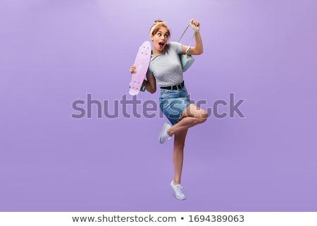 beautiful woman in a denim skirt stock photo © acidgrey