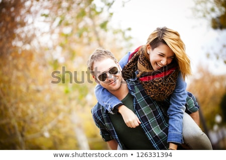 two playful pretty women and handsome young man stock photo © acidgrey