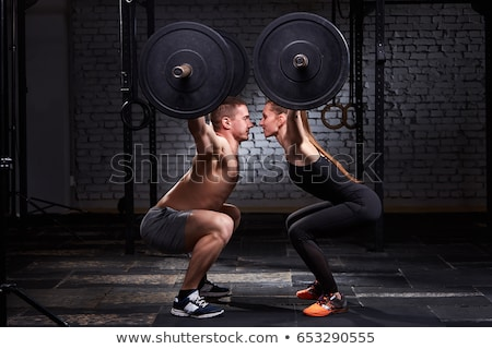 Lány súlyzó férfi súlyemelés bár edzés Stock fotó © lunamarina