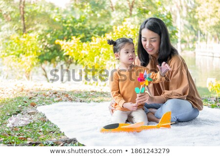 Mother and her daughter with a windmill stock photo © wavebreak_media