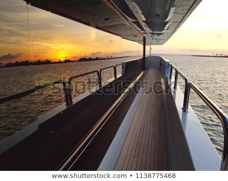 Stok fotoğraf: Gün · batımı · okyanus · güverte · yat · yelkencilik · güneş