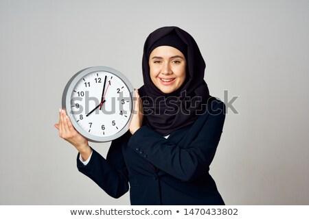 jovem · surpreendido · mulher · grande · relógio - foto stock © chesterf