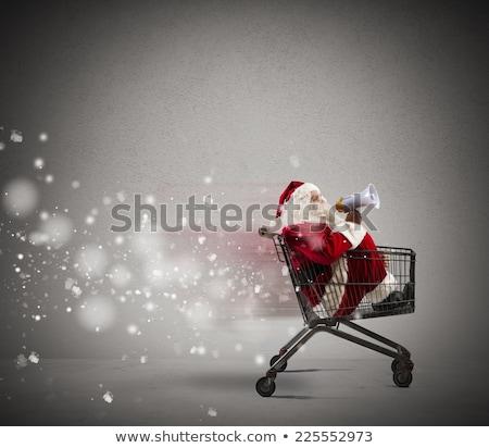 santa claus with megaphone in shopping cart stock photo © kirill_m