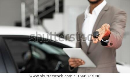 Stock photo: Guy showing car key, cropped image.