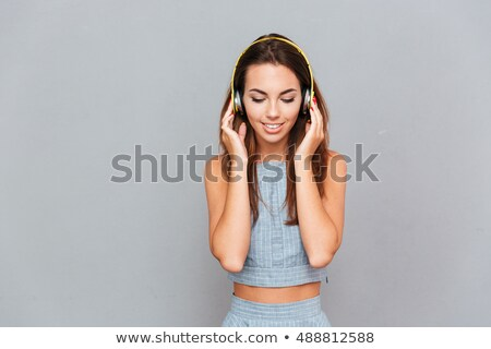 Stok fotoğraf: Girl With Headphones On The Grey Background