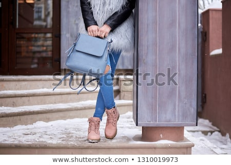 Young Woman Wearing Warm Winter Clothes And Fur Hat Holding Snow Stock photo © monkey_business