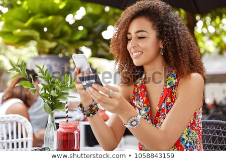happy young woman using credit card to make online purchase stock photo © nejron