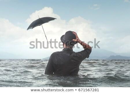 Zakenman slechte weer afbeelding hemel water achtergrond Stockfoto © magann