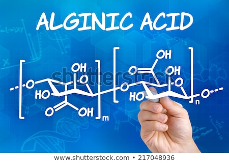 Hand with pen drawing the chemical formula of Alginic acid Stock photo © Zerbor