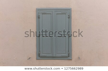 Old wooden rustic window closed with the shutters Stock photo © marekusz