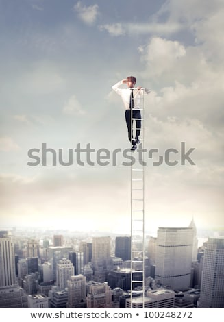 Businessman looks into the distance in career ladder concept Stock photo © vlad_star