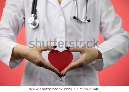 Close Up Of Doctor Holding Cardboard Heart Stock photo © HighwayStarz