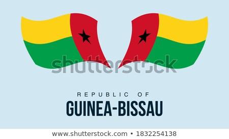 ストックフォト: Map On Flag Button Of Guinea Bissau