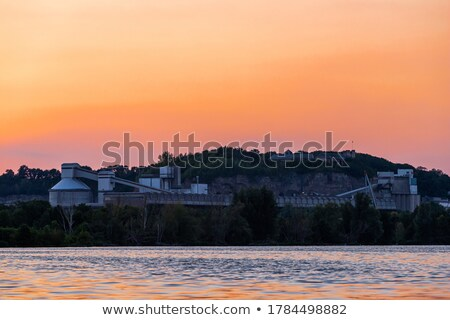 Silhouette old chemical factory at sunrise Stock photo © CaptureLight