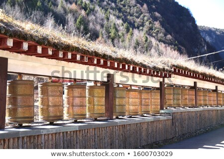 Row of golden bells in buddhist temple. Background of mountains in asia, tailandia Stock photo © Ainat