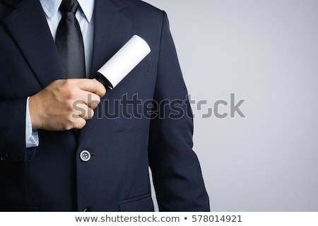 person hand removing dust with lint roller stock photo © andreypopov