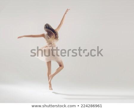 Portré akrobata gyönyörű nő pózol izolált fehér Stock fotó © deandrobot