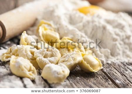 Házi készítésű tortellini fa asztal konyha tészta hús Stock fotó © asturianu