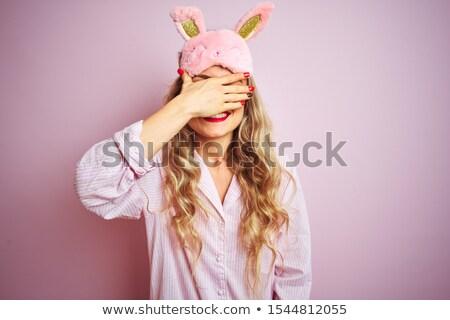 sleep mask blind blonderelaxed on pink stock photo © lunamarina