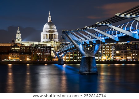 Millennium Bridge and St Pauls Cathedral at night in London Stock photo © chris2766